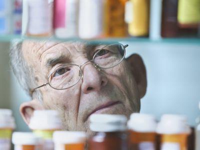 Man Looking in Medicine Cabinet