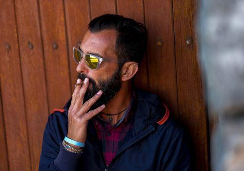 man smoking cigarillo