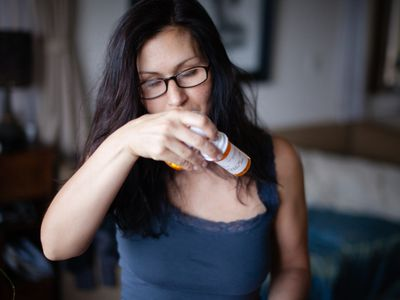 Woman With Pill Bottles
