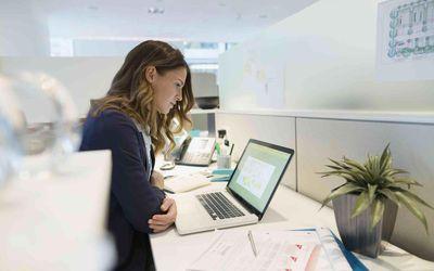 Woman at cubicle desk