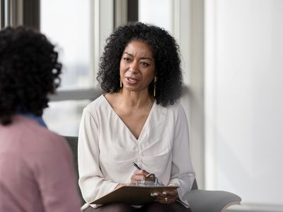 Therapist asks patient questions in session.