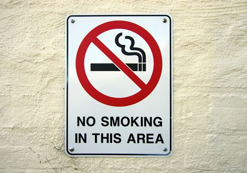 """A sign that reads """"No smoking in this area"""""""