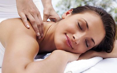 Woman being massaged at spa outdoors
