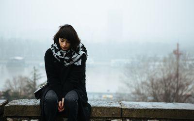Woman sitting alone outside