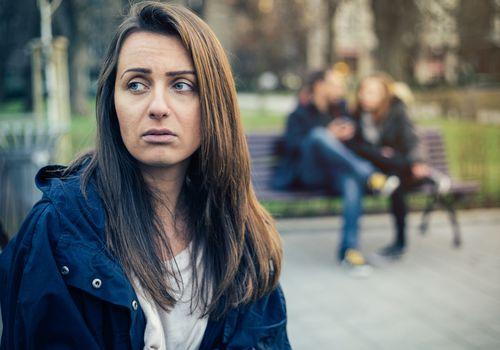 Anxious and sad woman outside