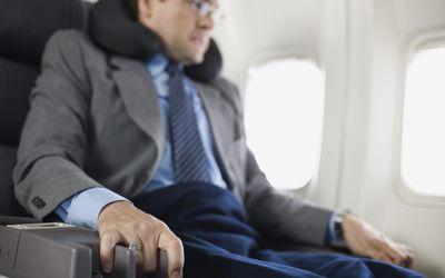 Nervous passenger sitting on airplane
