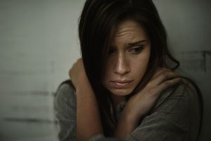 A young woman looking anxious and fearful