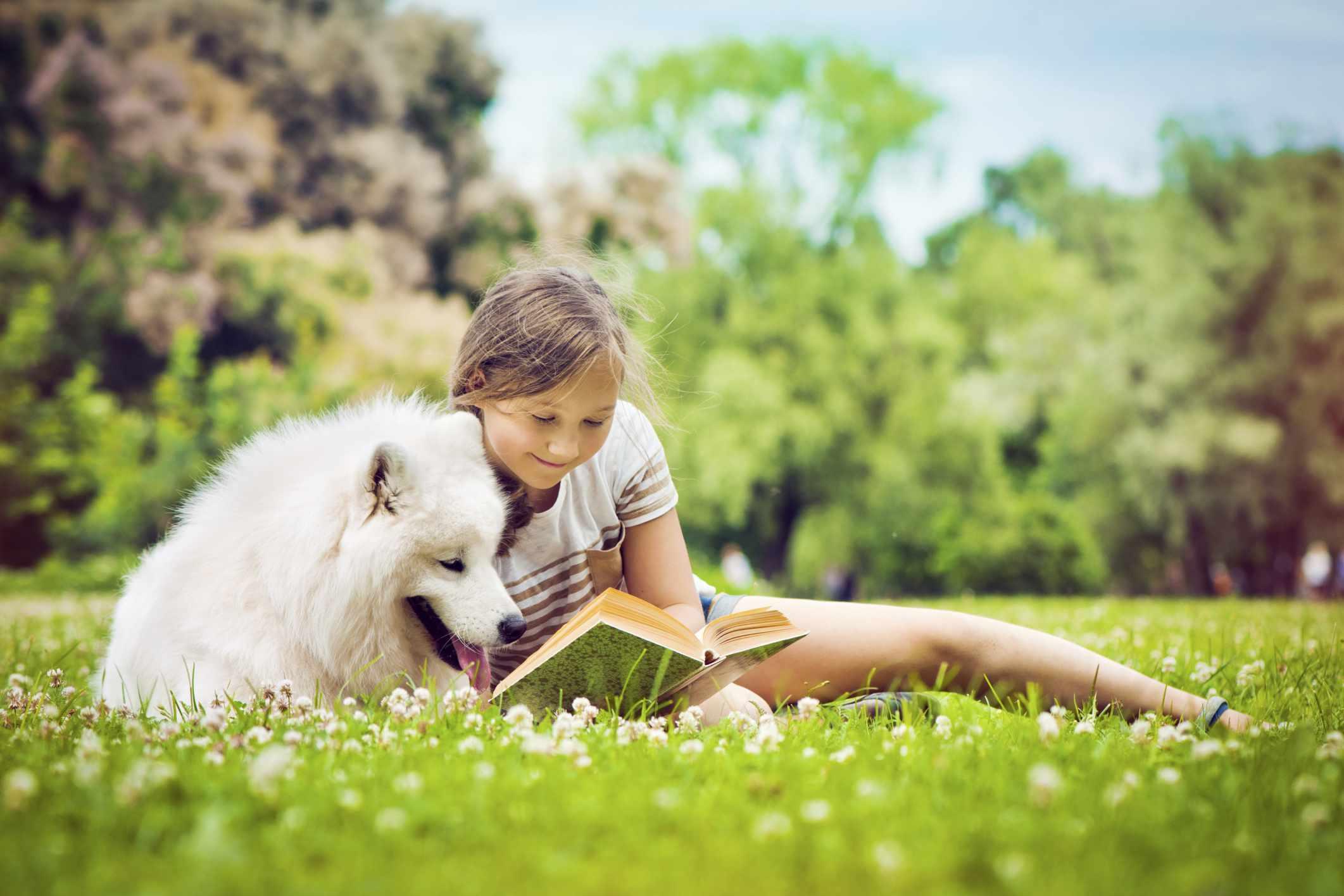kid-dog-reading-outside-summer-ArtMarie.jpg