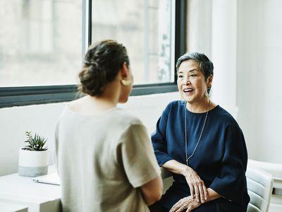 Two women speaking
