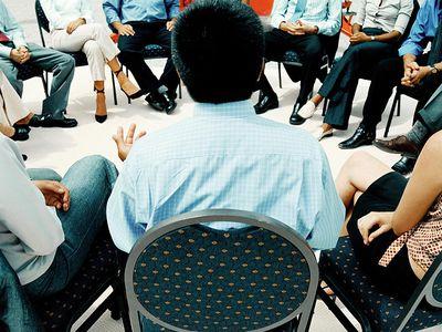 Man talking in AA meeting