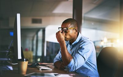 African American man stressed at work