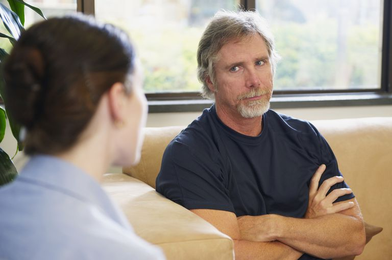 Worried patient talking with hospital administrator