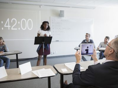 Student doing a debate in front of the class.