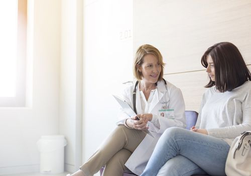 young woman and doctor talking