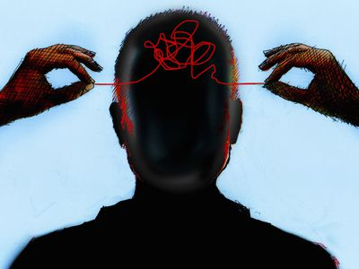 Hands untangling thread from inside of mans head