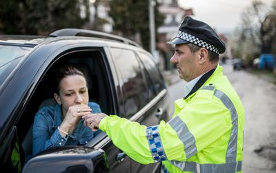 Traffic police officer stopped woman for alcohol test