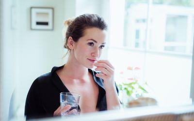 Woman taking chromium supplement