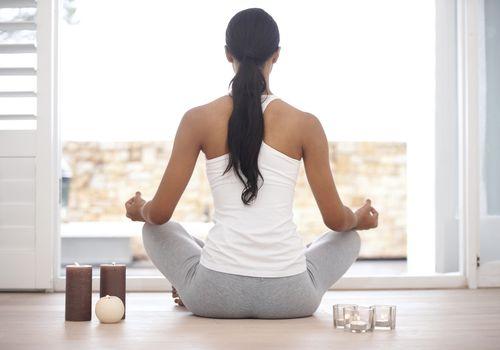 A woman meditating at home