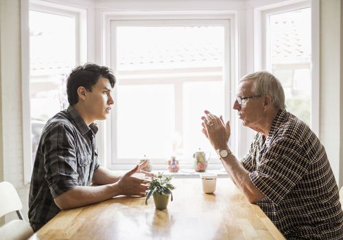 Young and old man having a discussion.