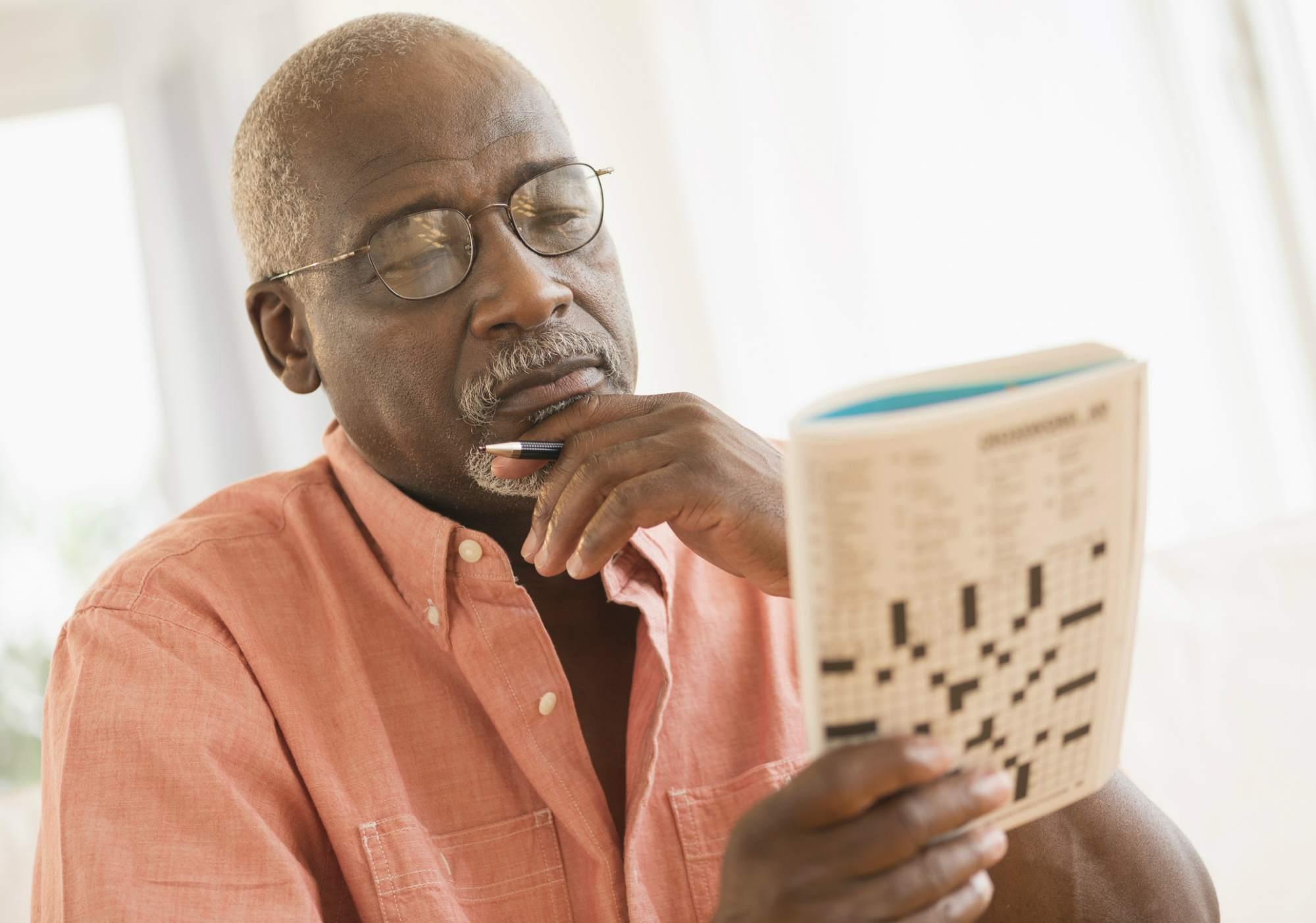 Older man doing a crossword