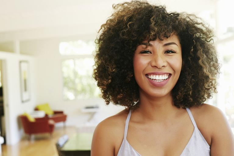 Warm-hearted mixed race woman