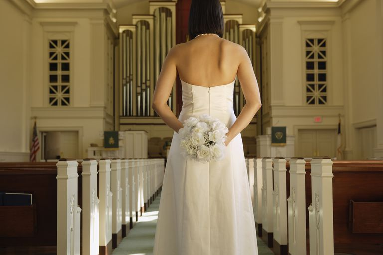 Bride standing in a church.