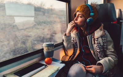 Traveler on a journey with train