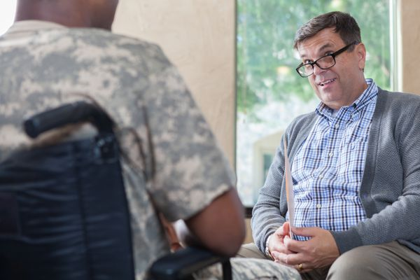 Counselor talks with soldier during therapy