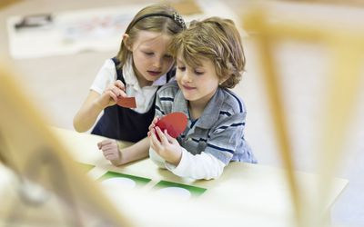 Children working together in classroom