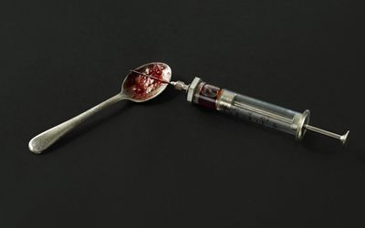 Heroin with a needle and spoon