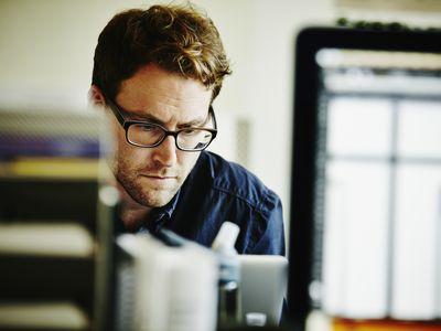 stressed man at office desk