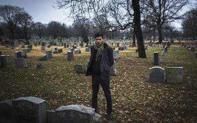 Man visiting graveyard