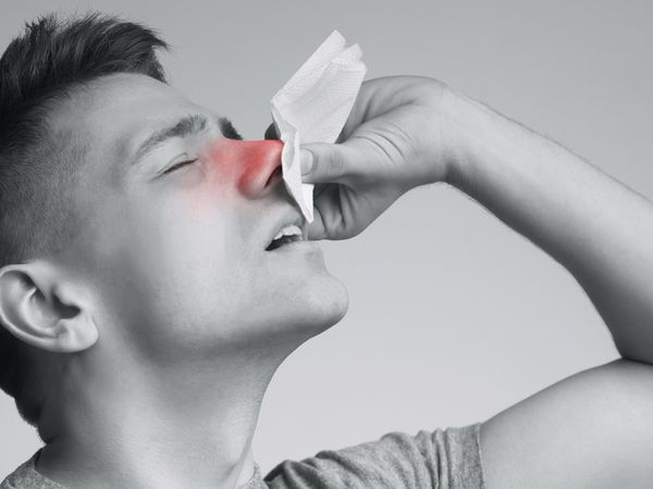 Young man suffering from nasal bleeding