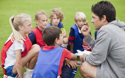 Kids surrounded by Physical education teacher