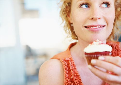 Woman holding a cupcake