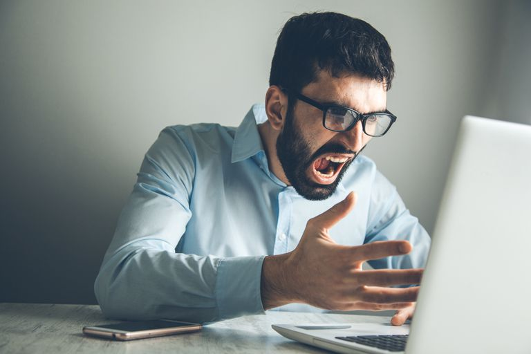 angry man using computer