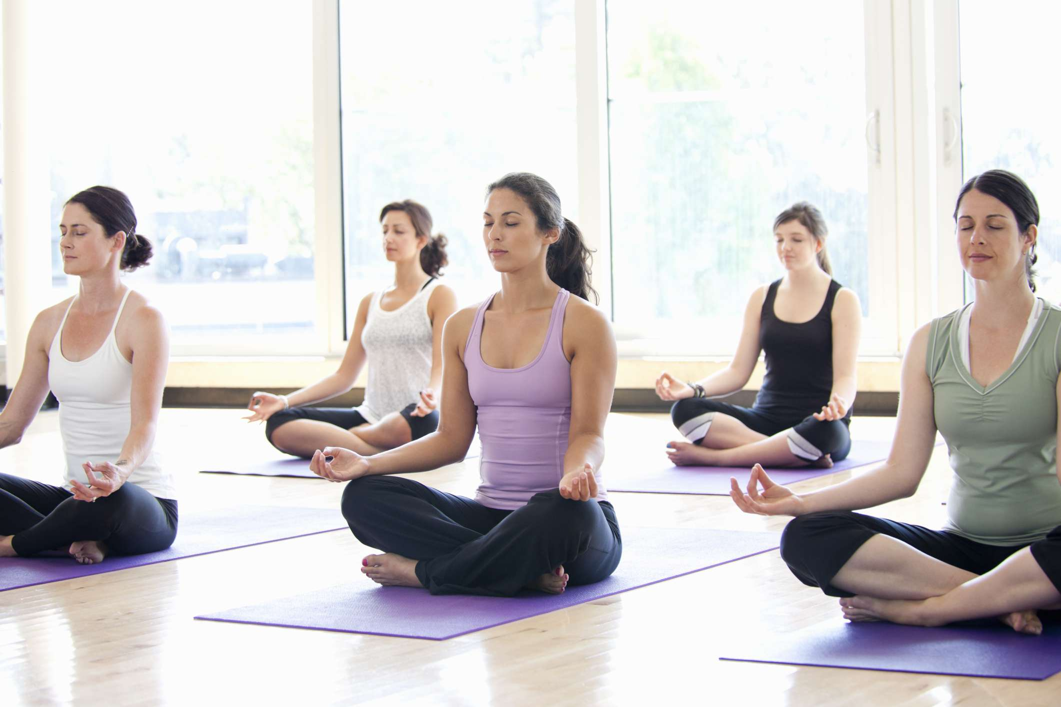 Women practicing yoga in a studio