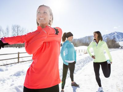 women stretching for exercise outdoors in winter