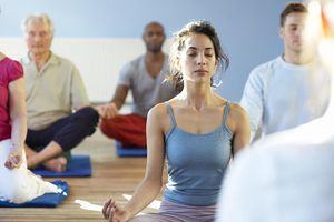A meditation class taking instruction from the teacher