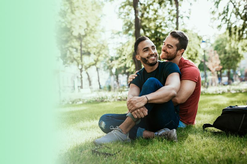 Couple sitting in the grass together