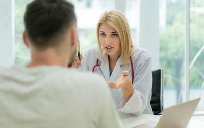 Therapist working with client