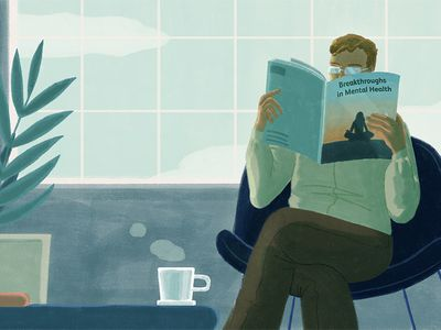 Man reading a magazine on breakthroughs in mental health