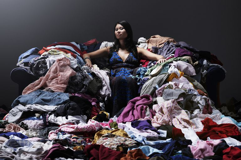 A woman hoarding clothes.