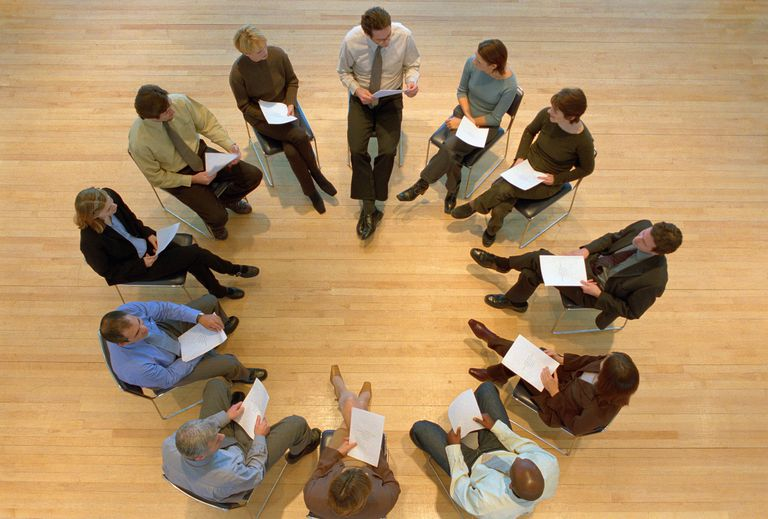 people in support group circle