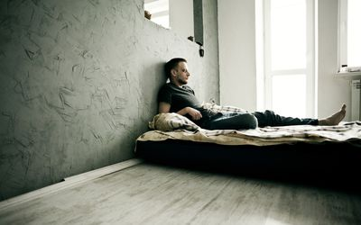 depressed man in bed