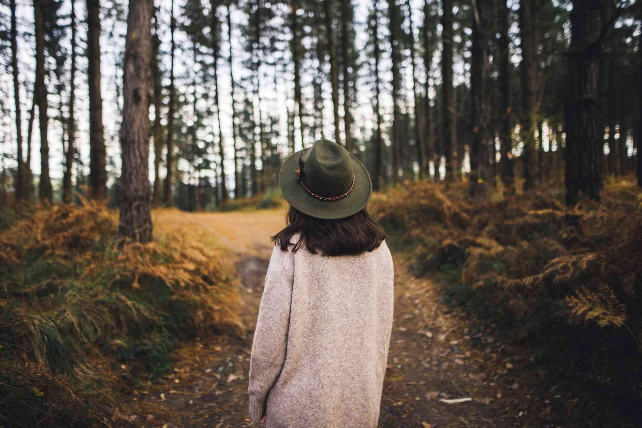 Woman strolling through the woods