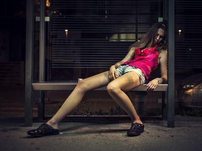 drug addict sleeping on the bus station