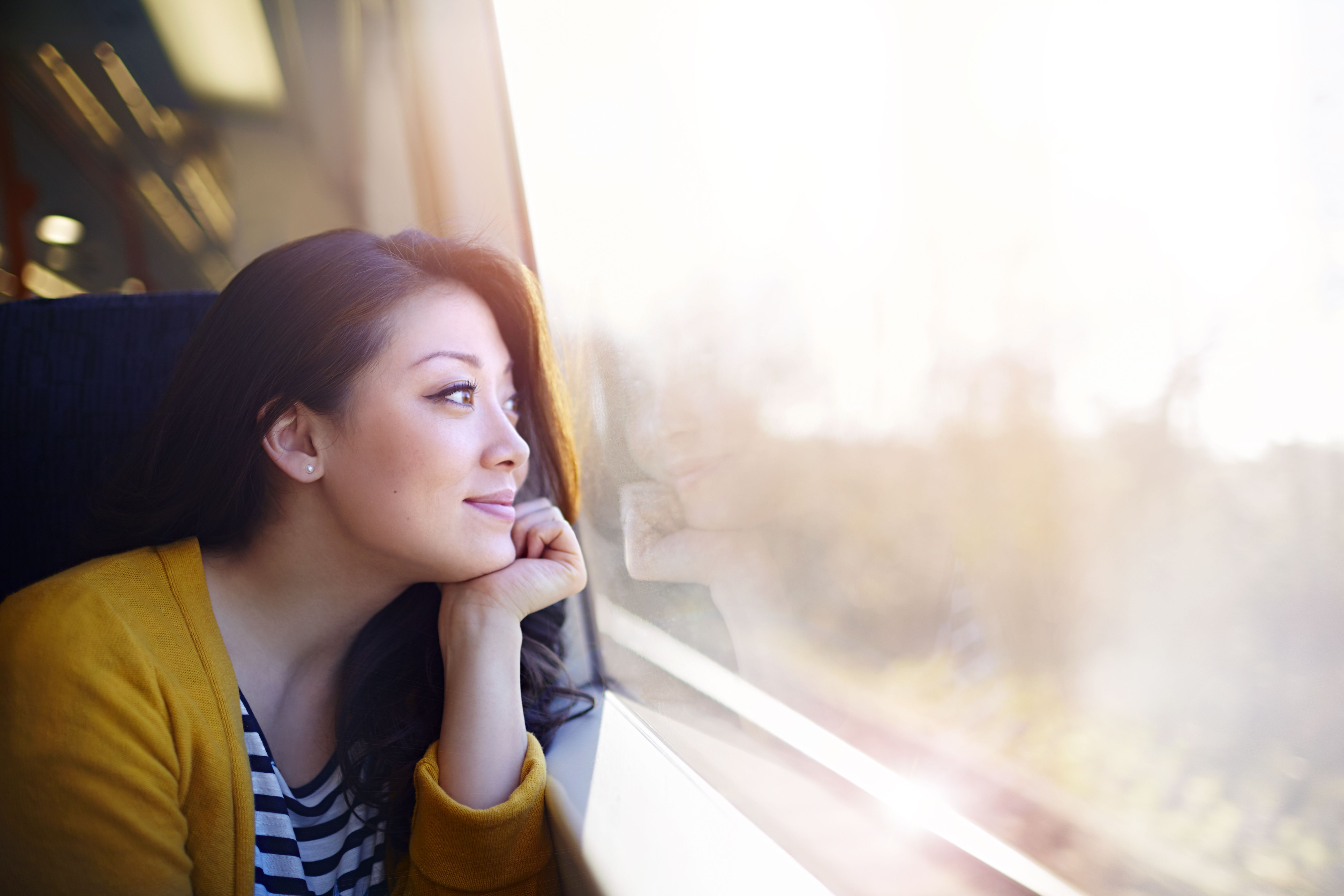 Smiling woman looking out window.