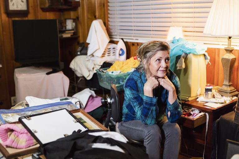 Senior woman at home, messy room