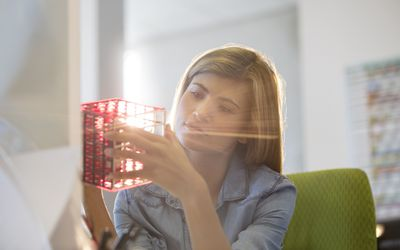 Woman playing with cube.
